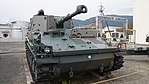 JGSDF Type 74 105 mm Self-Propelled Howitzer(No.0014K) right front view at Camp Nihonbara October 1, 2017.jpg