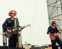Jakob Dylan and Stuart Mathis playing guitar and singing onstage