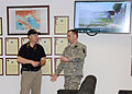James Sweatman, the range and training land and integrated training area management officer, speaks with a U.S. Soldier assigned to the 509th Signal Battalion, on training requirements at Caserma Ederle 130410-A-DO858-006.jpg