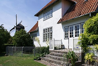 Johannes Larsen - Johannes Larsen's home 1901–64, now part of the Johannes Larsen Museum. In the background the windmill Svanemøllen, which delivered a small income until the death of the artist in 1964, is now restored, is part of the museum, and functions on special occasions