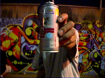 An aerosol paint can, a common tool used in modern graffiti KRESS.jpg