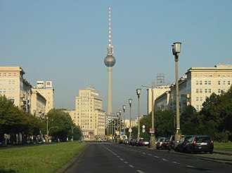 Hermann Henselmann - Karl-Marx-Allee, towards Strausberger Platz. The TV tower at Alexanderplatz is visible in the background (the initial design concept for the tower was created by Henselmann)