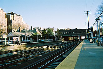 Kew Gardens station (LIRR) - The Kew Gardens station and the Lefferts Boulevard Bridge as seen from the eastbound platform.