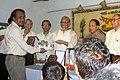Khondakar Ashraf Hossain receiving honorary crest at 18th years celebration of Somujjol Subatas (02).jpg