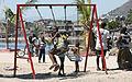 Kids on the Swings (7966333314).jpg
