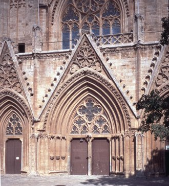 Lala Mustafa Pasha Mosque - St. Nicholas Cathedral, Famagusta, west door, probably completed by 1311. The pierced Gothic-style balustrade above the gable is a restoration of George H. Everett Jeffery.