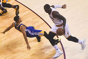 2016 NBA Finals - LeBron James charging at Stephen Curry during game six.