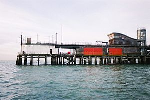 Southend-on-Sea Lifeboat Station - The pier head lifeboat station from the sea (the lifeboats live behind the red doors, and are launched by the davits)