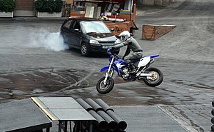 Moteurs... Action! Stunt Show Spectacular - A motorcycle performing a jump.