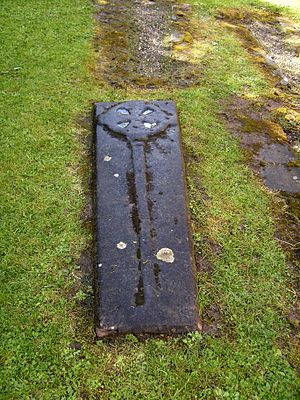 Lilleshall Abbey - Tombstone to the south of the abbey building. A desire to be buried in sacred ground was a major motive for donations to Lilleshall Abbey.