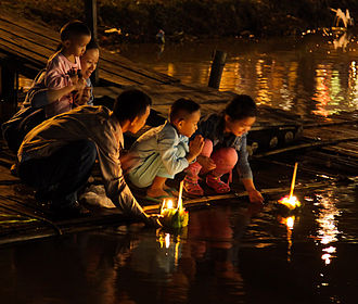 People floating krathong rafts during the Loi Krathong festival in Chiang Mai Loi Krathong 2010 John Shedrick.jpg