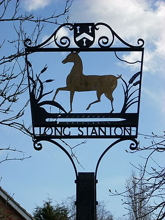 Village sign of Longstanton erected in 1981 to mark the marriage of the Prince of Wales