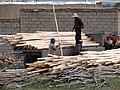 Lumberyard and Workers - Near Takht-e Soleiman - Western Iran (7421829976).jpg