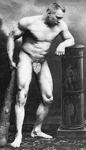 Georg Lurich -  Georg Lurich in a circa 1900–1905 postcard posed to show his physique.