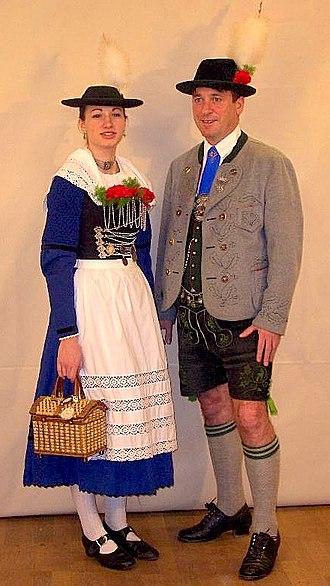 Lederhosen - A couple wearing Miesbacher Tracht. The man is wearing traditional Bavarian lederhosen.