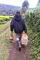 Man walking to work place(farm), carrying food.jpg