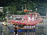 Boat decorated with colorful flowers.