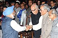 Manmohan Singh being greeted by Shri L.K. Advani, the former Vice President, Shri Bhairon Singh Shekhawat and the former Prime Minister, Shri I.K. Gujral, at a Swearing-in Ceremony, at Rashtrapati Bhavan, in New Delhi.jpg