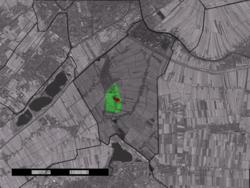 The town centre (red) and the statistical district (light green) of Zuidbuurt in the municipality of Zoeterwoude.
