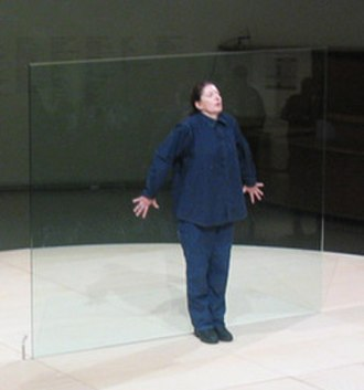 Marina Abramović - Abramović performing Bruce Nauman's Body Pressure, Guggenheim Museum, 2005