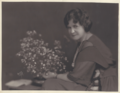 MaryHOConnorFacingWithFlowers.png