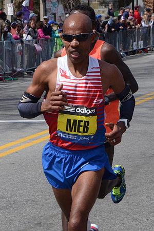 2014 Boston Marathon - Meb Keflezighi, male winner near halfway point in Wellesley