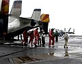 Members of the legendary Harlem Globetrotters Basketball Team, arrive aboard the U.S. Navy Nimitz Class Aircraft Carrier, USS DWIGHT D. EISENHOWER (CVN 69), on December 11, 2006. Th - DPLA - 33d26e669c7a9ec34492a6b1a23bf925.jpeg