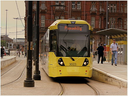 Metrolink in Manchester city centre, England, is an example of street-level light rail Metrolink tram at Lower Moseley Street..jpg