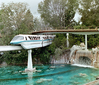 Disneyland Monorail System - Mark V Monorail Blue travels over the former Submarine Voyage in 2002.
