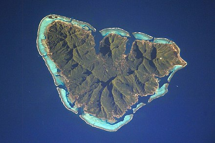 Moorea, a high island of volcanic origin where the central island is still prominent. Moorea ISS006.jpg
