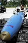 Munitions crew chiefs handle BDUs 120702-F-UP786-128.jpg