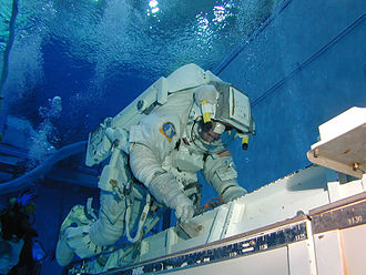 Johnson Space Center - A shuttle astronaut training in the Neutral Buoyancy Laboratory
