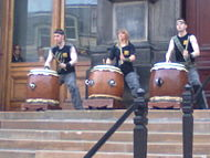 The Mugenkyo Taiko drummers performing on the museum steps