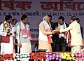 Narendra Modi being presented the traditional dress at the 85th Annual Conference of Srimanta Sankaradeva Sangha, at Sibasagar, Assam. The Minister of State for Youth Affairs and Sports (Independent Charge) (1).jpg