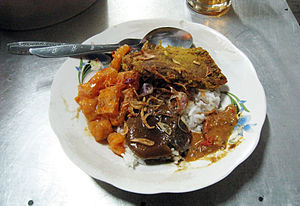 Nasi uduk - Nasi uduk with empal fried beef, semur jengkol and krechek (beef rind in spicy coconut milk)