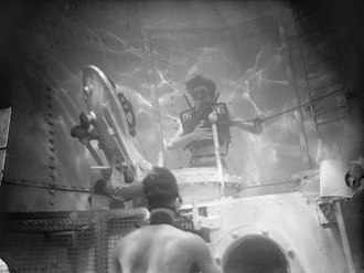 Scuba set - Davis Submerged Escape Apparatus being tested at the submarine escape test tank at HMS Dolphin, Gosport, 14 December 1942.