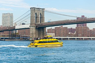 New York Water Taxi - The Gene Flatow on the East River approaching the Brooklyn Bridge