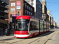 New streetcar 4404 heading south on Spadina, near King, 2014 12 20 (4) (15453009763).jpg