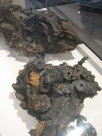 Effects of nuclear explosions on human health - Melted and fused pieces of metal (including coins that were in people's pockets) from the Atomic bombings of Japan. The melting of metal like this occurred during the ensuing fires and firestorms, long after the bombs had exploded.