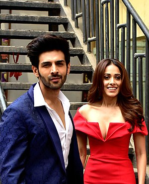 Aaryan and Nushrat Bharucha, pictured in 2018, have collaborated on four films, including Sonu Ke Titu Ki Sweety Nushrat-Bharucha-and-Kartik-Aaryan-on-the-sets-of-Indias-Next-Superstars-1 (cropped).jpg