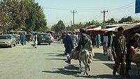 On the market street in Taloqan (8016345739).jpg
