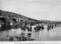 Ottoman troops in retreat from Lule Burgas across the bridge at Karisdiran (1912).png