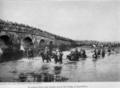 Ottoman troops in retreat from Lule Burgas across the bridge at Karisdiran (1912).png
