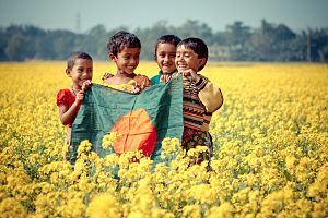 Flag of Bangladesh - Children holding the flag of Bangladesh.