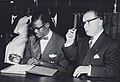 Patrice Lumumba signs the document granting independence to the Congo next to Belgian Prime Minister Gaston Eyskens.jpg