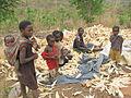 Peeling corn in the village in Zambia.JPG