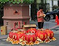 Penang Malaysia Chinese-woman-checking-a-delivery-of-chinese-lanterns-02.jpg