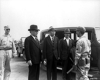 Second Philippine Republic - President Laurel, Speaker Aquino, and José Laurel III being taken into U.S. custody at Osaka Airport in 1945.