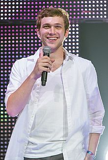 Phillip phillips discography wikipedia phillip phillips discography a man standing in front of a lighted backdrop wearing a white buttoned shirt open over m4hsunfo