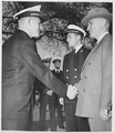 Photograph of President Truman shaking hands with Midshipman Charles Johnson of Silver Spring, Maryland, during his... - NARA - 198672.tif